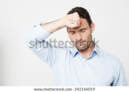 Disappointed man bothered by mistakes - stock photo