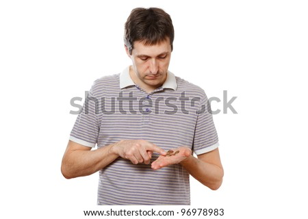 Disappointed man counting small  coins -  poverty, hardship concept