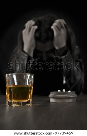 Disappointed man drinking alcohol on the bar - stock photo