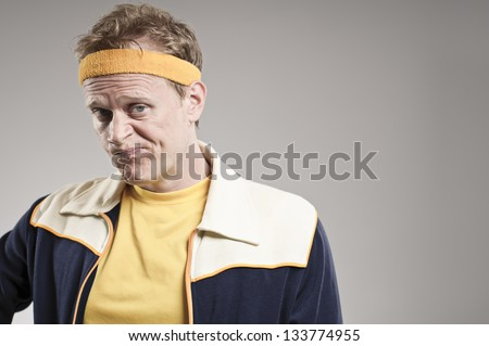Disappointed Retro Gym Coach Smirking - stock photo