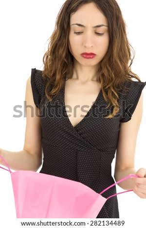 Disappointed shopping woman - stock photo