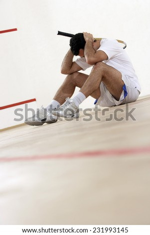 Disappointed Squash Player - stock photo