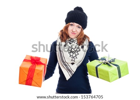 Disappointed woman in winter hat holding two presents, isolated on white background. - stock photo