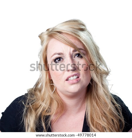 Disappointed woman sighs - stock photo