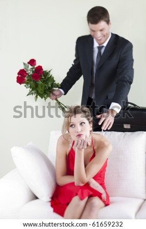 Disappointed woman unsuspecting her husband surprise - stock photo