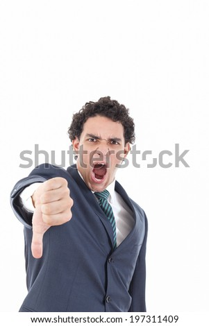 Disappointed young businessman showing thumb down sign yelling isolated on white, angry business man with disagreement gesture - stock photo