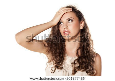 disappointed young girl holding a hand on forehead - stock photo