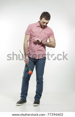 disappointed young man waiting for his date - stock photo
