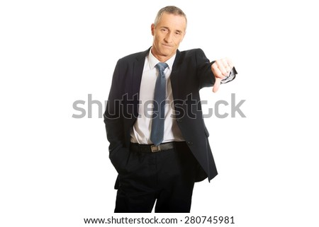 Disappointment businessman showing thumb down sign. - stock photo
