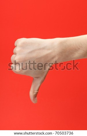 Disapproving gesture of a hand on red background - stock photo