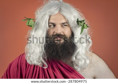 Disapproving god zeus or jupiter against orange background - stock photo