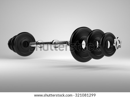 Disassembled dumbbell with chrome handle. Free weights area for workout in the gym.