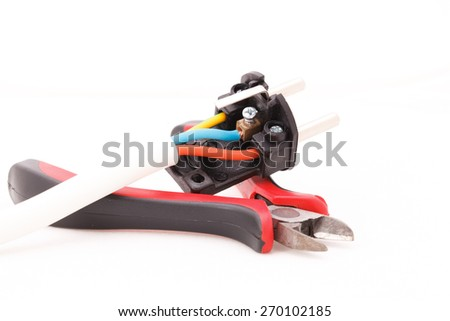 Disassembled electric plug power cord and  metal nippers - stock photo