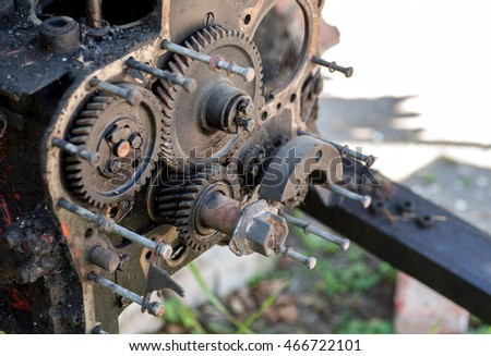 Disassembled engine with parts outdoors, selective focus
