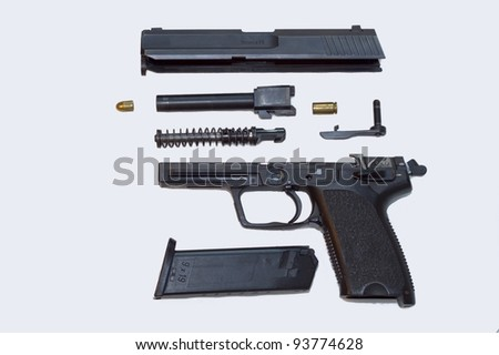 disassembled gun, isolated in white - stock photo