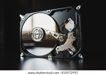 Disassembled hard drive from the computer (hdd) with mirror effects. Part of computer (pc, laptop) - stock photo