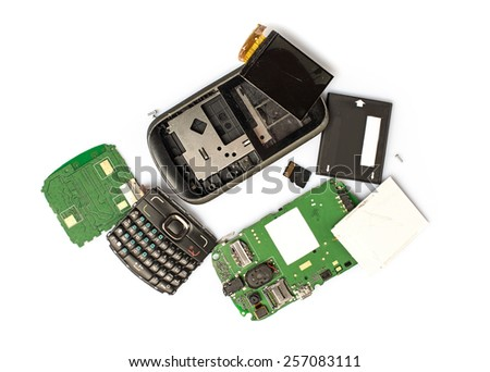 Disassembled mobile phone parts on white background - stock photo