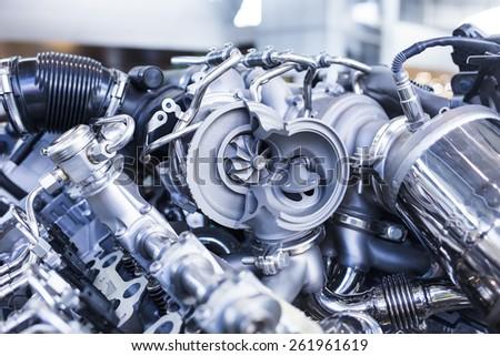Disassembled parts of sports vehicle motor - stock photo