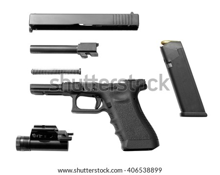 Disassembled pistol isolated on white background. Seperate pistol parts, slide, barrel, recoil spring, frame, magazine with ammunition and torch.