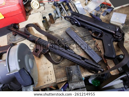 disassembled submachine gun MP-38. Gun locksmith workshop