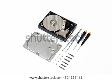 Disassemled HDD with tools on white background, flat lay