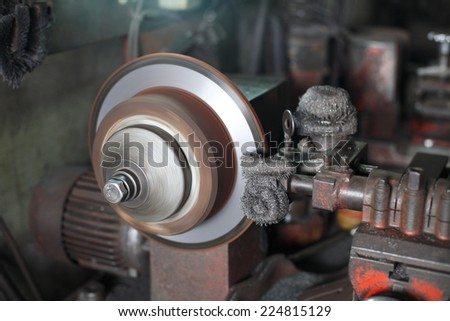 disc brake fixed by mechanic machine in the garage - stock photo