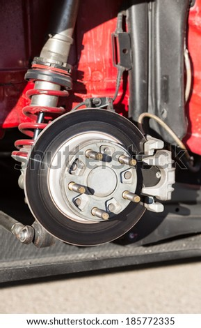 Disc brakes of a racing car - stock photo
