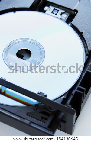 Disc inserted into dvd-drive - stock photo
