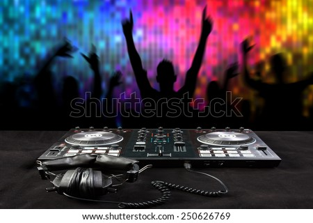 Disc Jockey mixes the track turntable to play music dance and crowd in nightclub at party  - stock photo