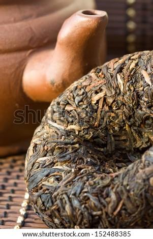 Disc Puer tea and ceramic teapot - stock photo