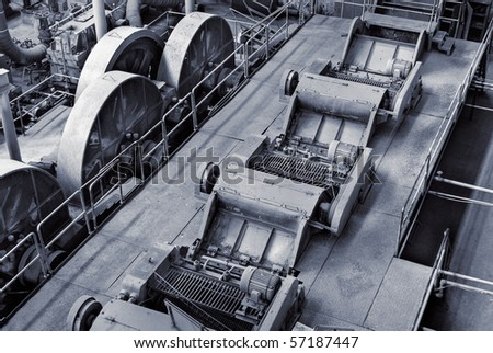 Discard factory interior with machine and industrial equipment .