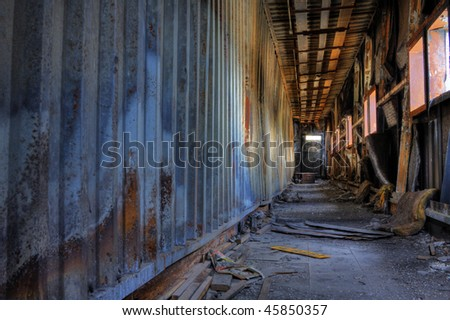 Discarded building, a peer after fire - stock photo