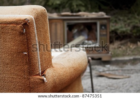 Discarded furniture at a dump site. - stock photo