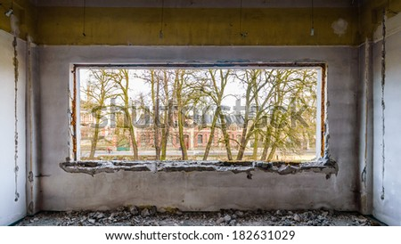 discarded ruin with old windows and wall, industrial window in concrete wall