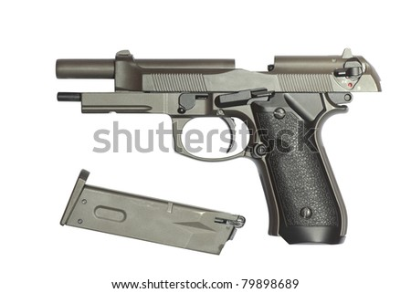 Discharged the gun and empty cartridge clip. Isolated on a white with clipping path inside.