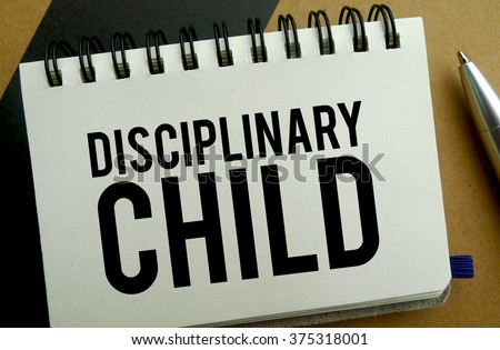 Disciplinary child memo written on a notebook with pen