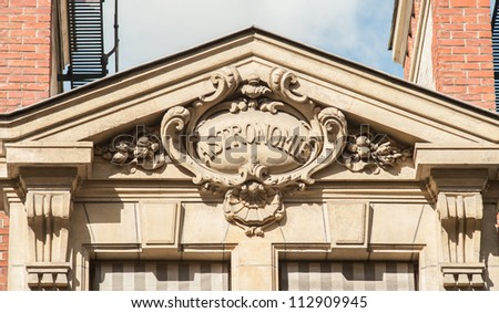 """Discipline sign on the top of the building of the University Sorbonne, """"astronomy"""" - stock photo"""