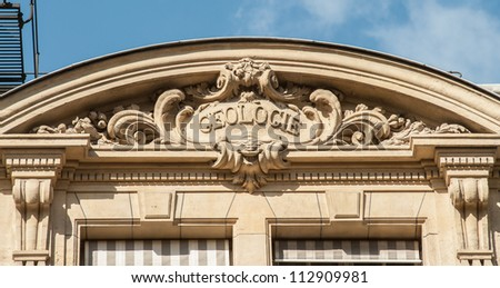 """Discipline sign on the top of the building of the University Sorbonne, """"geology"""" - stock photo"""