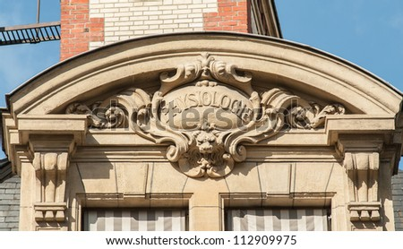 """Discipline sign on the top of the building of the University Sorbonne, """"physiology"""" - stock photo"""