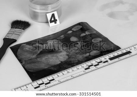 Disclosure of forensic evidence using fingerprint powders. - stock photo