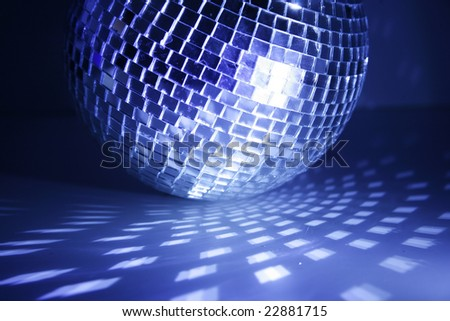 disco ball blue light and radial reflections - stock photo