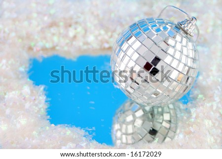 disco ball decoration with reflection surrounded by fake snow