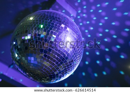 Disco ball reflecting purple green lights stock photo royalty free disco ball reflecting purple and green lights from the ceiling aloadofball Choice Image