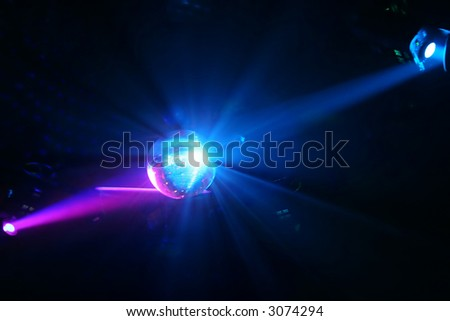 Disco Ball - Sphere - and fantastic light rays reflecting the light - stock photo
