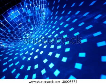Disco ball with blue illumination - stock photo
