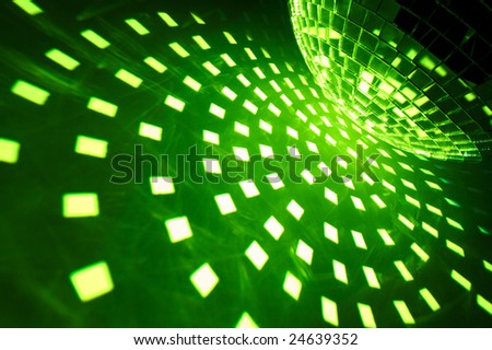 Disco ball with green illumination - stock photo