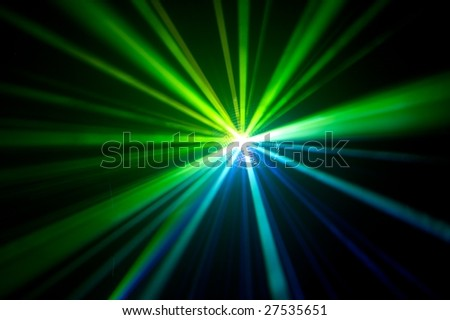 disco ball with green rays in haze - stock photo