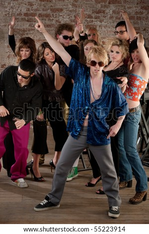 Disco dancing pose at a 1970s Disco Music Party - stock photo