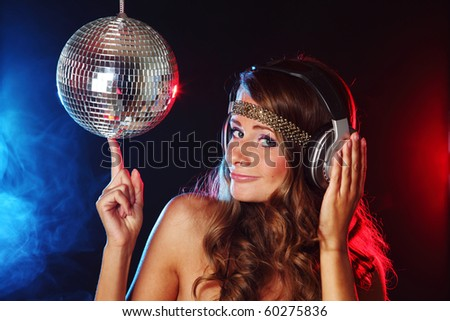 disco girl music in head phones - stock photo