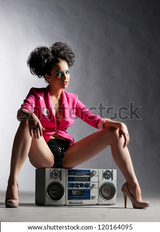 Disco girl with a tape recorder - stock photo